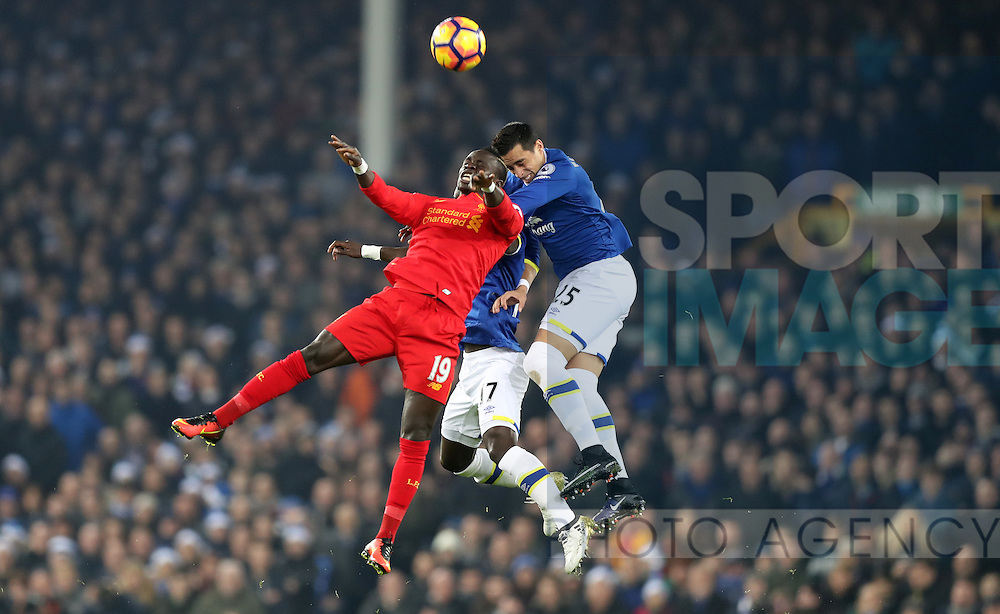 Ramiro Funes Mori of Everton jumps with Sadio Mané of Liverpool during the English Premier League match at Goodison Park, Liverpool. Picture date: December 19th, 2016. Photo credit should read: Lynne Cameron/Sportimage