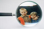 Picture of children viewed through magnifying glass