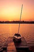 Best-selection-of-photo-decor-online-by-Randy-Wells-travel-photographer-videographer, Image of a sailboat at sunrise from across the bay at Mystic Seaport, Connecticut, American Northeast by Randy Wells