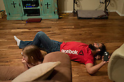Johny Hendricks watches tv with his two-year-old daughter, Adli, at their home in Midlothian, Texas on February 27, 2014.