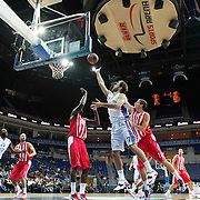 Anadolu Efes's Dario Saric (C), Stephane Lasme (L) and Olympiacos's Antreas Christodoulou (3ndR) during their Gloria Cup Basketball Tournament match Anadolu Efes between Olympiacos at Ulker Sports Arena in istanbul Turkey on Tuesday 23 September 2014. Photo by Aykut AKICI/TURKPIX