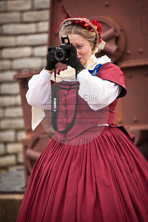 Antebellum re-enactor takes a photo with a digital camera during events at Fort Moultrie Charleston, SC. The re-enactors are part of the 150th commemoration of the US Civil War.