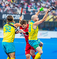 BHUBANESWAR, INDIA -  Liam Ansell(Eng) between Matthew Swann (Aus) and Jeremy Hayward (Aus) , England v Australia for the bronze medal during the Odisha World Cup Hockey for men  in the Kalinga Stadion.   COPYRIGHT KOEN SUYK