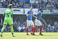 Portsmouth Midfielder, Tom Naylor (7) tells Portsmouth Goalkeeper, Craig MacGillivray (15) to calm down as they trail 0-1 during the EFL Sky Bet League 1 match between Portsmouth and Coventry City at Fratton Park, Portsmouth, England on 22 April 2019.