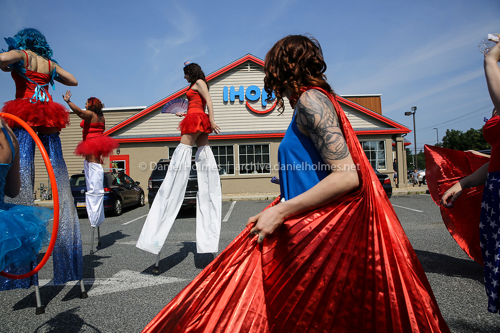 (7/4/19, MILFORD, MA) Stilt walkers from Extroidery Arts LLC., march during the Fourth of July Parade along  Medway Rd. in Milford on Thursday. [Daily News and Wicked Local Photo/Dan Holmes]