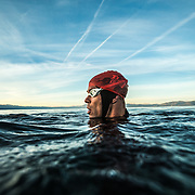 Bob Barry swimming / training on a cool Fall morning in Lake Tahoe, CA.<br /> <br /> <br /> Images by Trevor Clark of CLARKBOURNE Creative.
