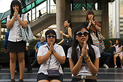Making merit at shrine of Central World