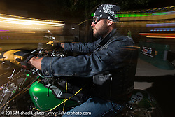 Friday night on Sturgis' Main Street during the 75th Annual Sturgis Black Hills Motorcycle Rally.  SD, USA.  August 7, 2015.  Photography ©2015 Michael Lichter.