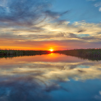 South Florida sunset photography from outdoor photographer Juergen Roth showing the edge of the Arthur R. Marshall Loxahatchee National Wildlife Refuge located west of Boynton Beach in Palm Beach County, FL. Arthur R. Marshall Loxahatchee National Wildlife Refuge is an amazing area for viewing wildlife and photography in Florida. <br /> <br /> Sunset photography images of the Arthur R. Marshall Loxahatchee National Wildlife Refuge area are available as museum quality photo prints, canvas prints, wood prints, acrylic prints or metal prints. Fine art prints may be framed and matted to the individual liking and decorating needs:<br /> <br /> https://juergen-roth.pixels.com/featured/arthur-r-marshall-loxahatchee-national-wildlife-refuge-juergen-roth.html<br /> <br /> All digital nature photo images are available for photography image licensing at www.RothGalleries.com. Please contact me direct with any questions or request.<br /> <br /> Good light and happy photo making!<br /> <br /> My best,<br /> <br /> Juergen<br /> Prints: http://www.rothgalleries.com<br /> Photo Blog: http://whereintheworldisjuergen.blogspot.com<br /> Instagram: https://www.instagram.com/rothgalleries<br /> Twitter: https://twitter.com/naturefineart<br /> Facebook: https://www.facebook.com/naturefineart