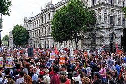 June 17, 2017 - London, England, United Kingdom - Protesters hold placards against coalition goverment in London, UK, on 17 June 2017. Over a thousand people gather outside downing street to protest against the Conservative, DUP coalition. (Credit Image: © Jay Shaw Baker/NurPhoto via ZUMA Press)