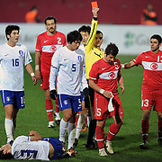 Referee's Sergii BOIKO show the red card to Turkey's Emre BELOZOGLU (2ndR) during their International friendly soccer match Turkey between South Korean at the Avni Aker stadium in Trabzon, Turkey on Wednesday 09 February 2011. Photo by TURKPIX