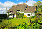 Pretty thatched country cottage and garden, Cherhill, Wiltshire, England, UK - property released