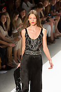 Evening trousers in a Fortunty-like black pleated silk with black sleveless beaded top. By Carlos Miele at the Spring 2013 Mercedes-Benz Fashion Week in New York.
