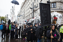 London, UK. 12 October, 2019. Thousands of climate activists from Extinction Rebellion, some bearing large model skeletons take part in the XR funeral march from Marble Arch to Russell Square on the sixth day of International Rebellion protests to demand a government declaration of a climate and ecological emergency, a commitment to halting biodiversity loss and net zero carbon emissions by 2025 and for the government to create and be led by the decisions of a Citizens' Assembly on climate and ecological justice. Credit: Mark Kerrison/Alamy Live News
