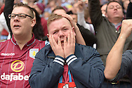 Aston Villa fan cry's after the final whilste as they see their team win and book their place in the final.  The FA Cup, semi final match, Aston Villa v Liverpool at Wembley Stadium in London on Sunday 19th April 2015.<br /> pic by John Patrick Fletcher, Andrew Orchard sports photography.