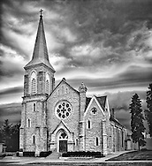 An ominous, early morning storm approaches Batavia's old Holy Cross Church on Wilson Street.