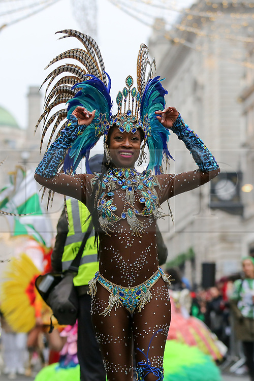 © Licensed to London News Pictures. 01/01/2020. London, UK. A performer from London School of Samba performs during the London New Year's Day Parade in central London. Over 10,000 performers representing the London boroughs and countries from across the globe are parading from Piccadilly Circus to Parliament Square as tens of thousands of Londoners and tourists line the route. Every year, dancers, acrobats, cheerleaders, marching bands, historic vehicles and more assemble in the heart of the capital for a colourful celebration of contemporary performances and traditional pomp and ceremony. Photo credit: Dinendra Haria/LNP