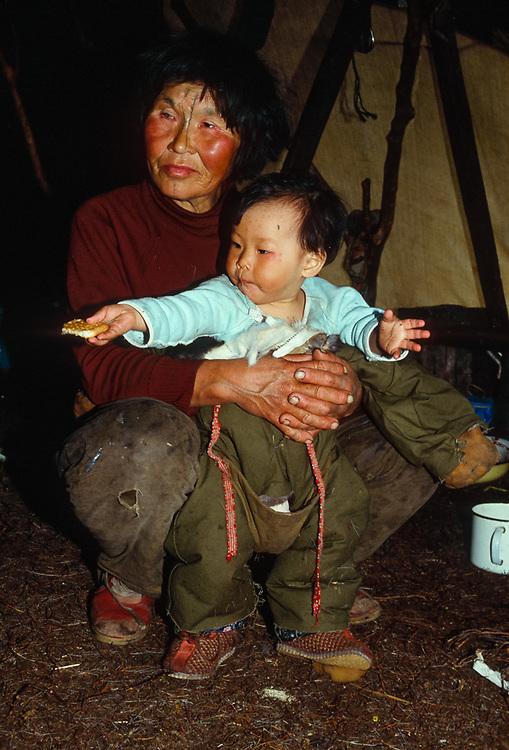 Olga Tinachvanau and grand daughter in yranga, Chukchi reindeer camp Bering Sea coastline, Chukotsk Peninsula, NE Russia, 1992