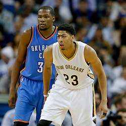 Dec 2, 2014; New Orleans, LA, USA; New Orleans Pelicans forward Anthony Davis (23) and Oklahoma City Thunder forward Kevin Durant (35) during the second half of a game at the Smoothie King Center. The Pelicans defeated the Thunder 112-104. Mandatory Credit: Derick E. Hingle-USA TODAY Sports