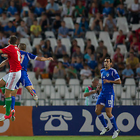 Israel's Din Mori (R) watches as Hungary's Adam Pinter (L) and Israel's Eitey Menachem Shechter (C) jump for a header during the Friendly football match Hungary playing against Israel in Budapest, Hungary on August 15, 2012. ATTILA VOLGYI