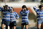 Girls from tecnico team adjusting their hair after their opponent team scored.