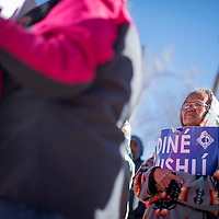"""122314       Cable Hoover<br /> <br /> Lettie Nave clutches a sign that says """"Diné Nishlí"""" of """"I am Diné"""" during a voting protest in Window Rock Tuesday."""