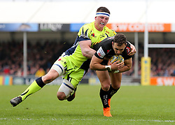 Exeter Chiefs Nic White scores a try, as he is tackled by Sale Sharks Ben Curry during the Aviva Premiership match at Sandy Park, Exeter.