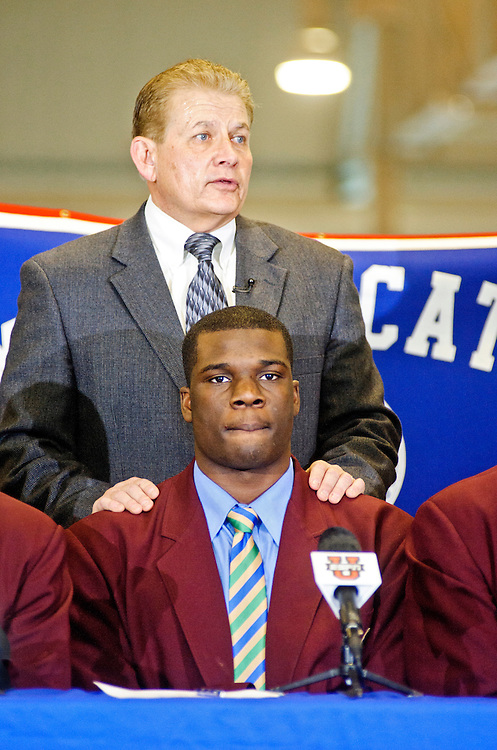 """Head football coach and DeMatha's Athletic director Bill McGregor talks about Cyrus Kouandjio, one of the nation's top high school football players who took until the last minute to announce which school he was committing to. After reportedly staying up all night, the 6'7"""" offensive tackle announced at DeMatha's signing ceremony in the school's Convocation Center that he will be playing for Auburn, not Alabama where his older brother plays. He, however, did not sign his letter of intent at the event. Three days later he committed to play for the Crimson Tide."""