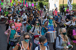 Members of the XR Samba Band join fellow climate activists from Extinction Rebellion in marching to a Back The Bill rally in Parliament Square from Buckingham Palace on 1st September 2020 in London, United Kingdom. Extinction Rebellion activists are attending a series of September Rebellion protests around the UK to call on politicians to back the Climate and Ecological Emergency Bill (CEE Bill) which requires, among other measures, a serious plan to deal with the UK's share of emissions and to halt critical rises in global temperatures and for ordinary people to be involved in future environmental planning by means of a Citizens' Assembly.