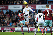 Ki Sung-Yueng of Swansea City (c)competes with Alex Song of West Ham United. Barclays Premier league match, West Ham Utd v Swansea city at the Boleyn ground, Upton Park in London on Sunday 7th December 2014.<br /> pic by John Patrick Fletcher, Andrew Orchard sports photography.