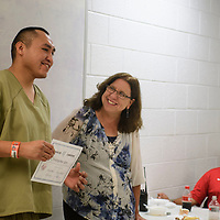 Christopher Sam is presented a certificate from Katrina Marti, a case manager at the McKinley County Adult Detention Center for graduating from a 28-day substance abuse Treatment Program at the McKinley County Adult Detention Center, Thursday, August 16, 2018.