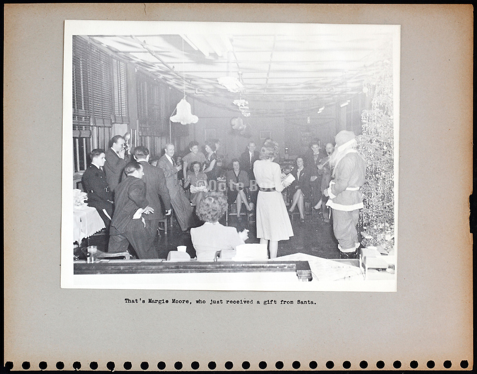 page from a photo album celebrating Christmas at company office USA 1946