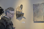"""Roslyn, New York, USA. January 31, 2015. Metal sculpture by artist Thea Lanzisero is one of the works of art on exhibit at Artists Reception for """"The Alchemists"""" at Bryant Library."""