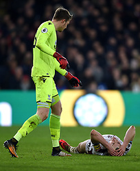 """Crystal Palace goalkeeper Wayne Hennessey helps up Burnley's Ashley Barnes during the Premier League match at Selhurst Park, London. PRESS ASSOCIATION Photo. Picture date: Saturday January 13, 2018. See PA story SOCCER Palace. Photo credit should read: Daniel Hambury/PA Wire. RESTRICTIONS: EDITORIAL USE ONLY No use with unauthorised audio, video, data, fixture lists, club/league logos or """"live"""" services. Online in-match use limited to 75 images, no video emulation. No use in betting, games or single club/league/player publications"""