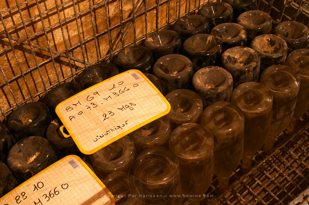 The Vinotheque (wine library) with small numbers of older bottles stacked stored upside down on their heads 23 magnum bottles of the 1969 vintage Brut Millesime at Champagne Deutz in Ay, Vallee de la Marne, Champagne, Marne, Ardennes, France
