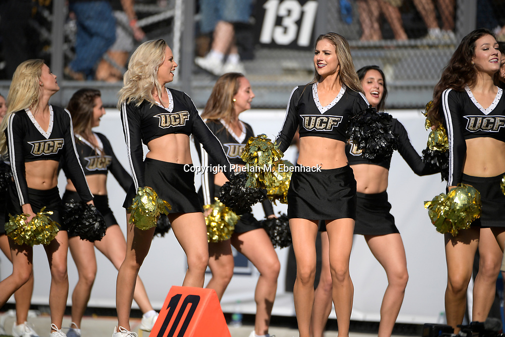 Central Florida dance squad members perform on the sideline during the second half of the American Athletic Conference championship NCAA college football game against Memphis Saturday, Dec. 2, 2017, in Orlando, Fla. Central Florida won 62-55. (Photo by Phelan M. Ebenhack)