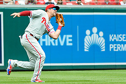 May 6, 2018 - Washington, DC, U.S. - WASHINGTON, DC - MAY 06:  Philadelphia Phillies left fielder Rhys Hoskins (17) runs down a fly ball in the first inning during the game between the Philadelphia Phillies and the Washington Nationals on May 6, 2018, at Nationals Park, in Washington D.C.  The Washington Nationals defeated the Philadelphia Phillies, 5-4.  (Photo by Mark Goldman/Icon Sportswire) (Credit Image: © Mark Goldman/Icon SMI via ZUMA Press)