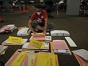 After Milwaukee's absentee ballots are opened and sorted, they need to be re-folded in order to be scanned and counted at the Central Count location.