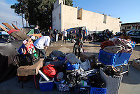 Residents keep their possessions together during Monday's eviction at 38 Soledad St.