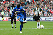 Adebayo Akinfenwa of AFC Wimbledon scores his teams 2nd goal from a penalty to make it 2-0. Skybet football league two play off final match, AFC Wimbledon v Plymouth Argyle at Wembley Stadium in London on Monday 30th May 2016.<br /> pic by John Patrick Fletcher, Andrew Orchard sports photography.