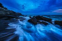 Twilight blues and crashing waves along the rugge coast of Acadia National Park, ME USA
