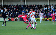 Richard Orlu tackles Byron Harrison during the The FA Cup match between Cheltenham Town and Dover Athletic at Whaddon Road, Cheltenham, England on 7 December 2014.