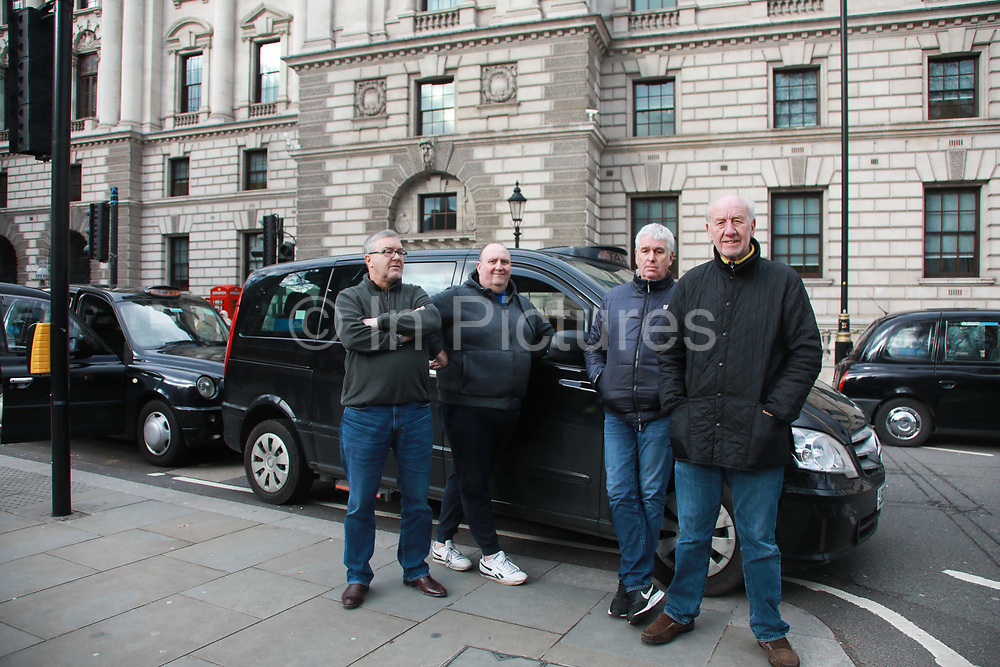 Licensed taxi drivers block the traffic in Parliament Square between 1pm-4pm in protest against traffic policies, 11th of February 2019, Central London, United Kingdom.Taxi drivers stand in Parliament Square, next to their parked up cabs. The disgruntled taxi drivers feel squeezed by local government transport policies. They say they will continue their protest and blockade the square every other day the same time until they feel the Mayor of London listens to them.