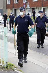 © Licensed to London News Pictures. 09/08/2012 .Police search teams still working hard at 4.45pm, searching rubbish bins on the Fieldway Estate opposite the Fieldway Community Centre in New Addington. Sixth day (09.08.2012) Tia Sharp has been missing..  12 years old Tia Sharp has been missing from the Lindens on The Fieldway Estate in New Addington,Croydon,Surrey since Friday last week. .Photo credit : Grant Falvey/LNP