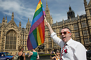 London Gay Men's Chorus sing outside Parliament in London, UK, ahead of the final reading of the 'Marriage Bill 2012-13 to 2013-14'. A Bill to make provision for the marriage of same sex couples in England and Wales.