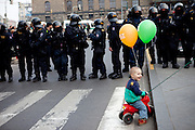 Prague/Czech Republic, CZE, 05.04.2009: Child in front of special forces of the Czech police during a demonstration against the planned US military radar base in Czech Republic at Wenceslav square on the day of Barack Obamas participation on the EU-US summit in Prague.
