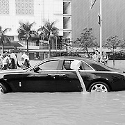 in January 2013 Jakarta experienced major flooding. Here a Rolls Royce Phantom gets stranded. In a twist of irony, the owner bails out water from inside using a plastic container whilst his chauffeur sits in the front....proving that when disaster strikes, we are all equal.