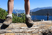 Female hiker in hiking boots at Mount Tallac trailhead overlooking lake Tahoe, California, USA