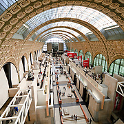Main hall of Musée d'Orsay, formerly a train station (Gare d'Orsay) and now an art gallery dedicated to French art of the 1848 to 1915 period. Includes extension collection of masterpieces by painters such as Renoir, Cezanne, Monet, and Degas.