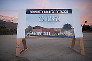 A promotional sign showcases a rendering of the Community College Extension during the Milpitas Unified School District and San Jose Evergreen Community College District Community College Extension Ground Breaking Ceremony near Russell Middle School in Milpitas, California, on November 17, 2015. (Stan Olszewski/SOSKIphoto)